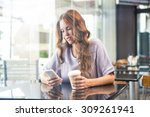 pretty brunette enjoying a...   Shutterstock . vector #309261941