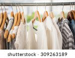 clothes on clothes rail in... | Shutterstock . vector #309263189