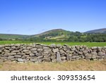 A Dry Stone Wall In Front Of...