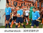 Small photo of LVIV, UKRAINE - AUG 5: Chief Arbiter Felix Zvayer (C) enters the fieldduring the UEFA Champions League match between Shakhtar vs Fenerbahce, 5 August 2015, Arena Lviv, Lviv, Ukraine