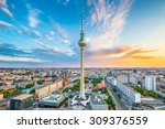 Stock photo aerial view of berlin skyline with famous tv tower at alexanderplatz and dramatic cloudscape at 309376559