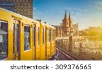 Stock photo panoramic view of berliner u bahn with oberbaum bridge in the background in golden evening light at 309376565