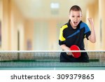 Small photo of Portrait Of Kid Playing Tennis celebrating flawless victory in table tennis