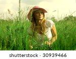 young woman in grass field | Shutterstock . vector #30939466