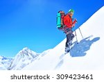 a climber reaching the summit | Shutterstock . vector #309423461