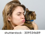 young beautiful woman with cat | Shutterstock . vector #309534689
