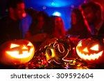 masks and pumpkins at halloween ... | Shutterstock . vector #309592604