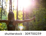 young blonde woman working out... | Shutterstock . vector #309700259