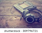 dj equipment on rustic wooden... | Shutterstock . vector #309796721