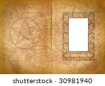 occult book pages with watermark of an pentagram and ornamented picture frame - stock photo