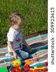 little boy playing constructor... | Shutterstock . vector #309923615