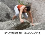 woman climbing forest of... | Shutterstock . vector #310006445