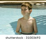 Boy bathing in a pool - stock photo
