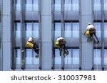 Three Climbers Wash Windows An...