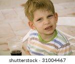 Kid drinking soda - stock photo