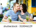 young couple at cafe enjoying... | Shutterstock . vector #310046129