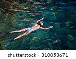 young woman snorkeling in... | Shutterstock . vector #310053671