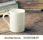 White Coffee Cup On Wooden...