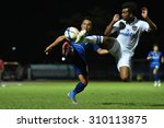 Small photo of AYUTTHAYA THAILAND-AUGUST19:Tanat Chantaya(L)of Ayutthaya F.C.in action during Yamaha League One 2015 between Ayutthaya F.C.and Songkhla UTD at Ayutthaya Province Stadium on August19,2015in Thailand