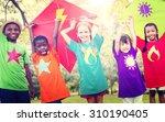 children flying kite playful... | Shutterstock . vector #310190405