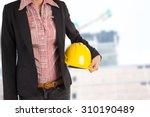 engineer holding yellow helmet... | Shutterstock . vector #310190489