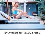 asia beautiful woman using a... | Shutterstock . vector #310257857