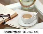 cup of coffee on table close up | Shutterstock . vector #310263521