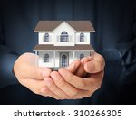 holding house representing home ... | Shutterstock . vector #310266305