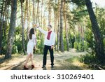 beautiful young couple in love... | Shutterstock . vector #310269401