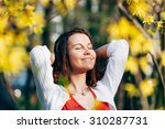 young woman sunbathing in the... | Shutterstock . vector #310287731