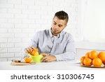 young man using citrus fruit... | Shutterstock . vector #310306745