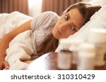unhappy woman looking at... | Shutterstock . vector #310310429