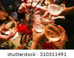 clinking glasses with alcohol... | Shutterstock . vector #310311491