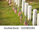 American Flags Near Gravestone...