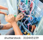 air conditioning technician and ... | Shutterstock . vector #310445159