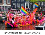 Small photo of Amsterdam, Netherlands - August 2, 2014: Participants at the famous Canal Parade of the Amsterdam Gay Pride 2014. Every year the parade is visited by more than 400000 people.