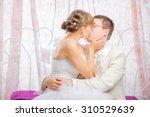 bride and groom in wedding... | Shutterstock . vector #310529639