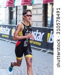 Small photo of STOCKHOLM - AUG 22: Women ITU World Triathlon event Aug 22 2015. Woman running in Old town. Bravo, Elizabeth (ECU).