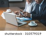 cropped image of business... | Shutterstock . vector #310579319