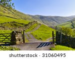 Landscape View Of A Gate And...