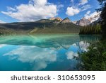 serenity emerald lake in the... | Shutterstock . vector #310653095