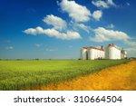 Agricultural Silos Under Blue...