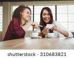 female friends having coffee... | Shutterstock . vector #310683821