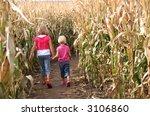 Two Children Spending An Autum...