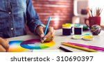 graphic designer drawing on...   Shutterstock . vector #310690397