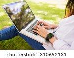 beautiful brunette using laptop ... | Shutterstock . vector #310692131