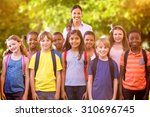 cute pupils smiling at camera...   Shutterstock . vector #310696745