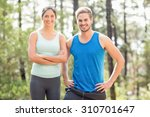 happy joggers looking at camera ... | Shutterstock . vector #310701647