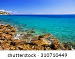 turquise water of the bay on... | Shutterstock . vector #310710449