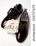 Small photo of stylish claret shoes and accessories